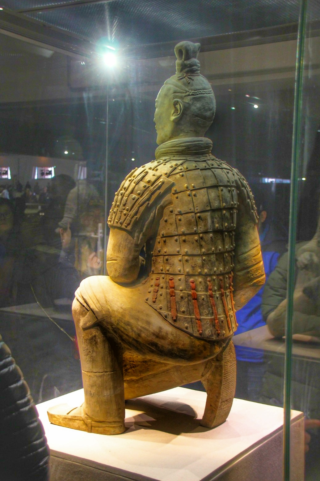 The terracotta soldiers were initially painted in various colors, this archer still exhibits the red stripes.