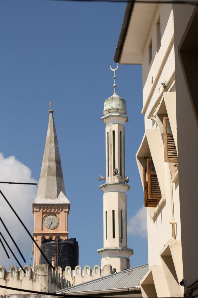 An example of typical Zanzbiarese tolerance: the church tower alongside a minaret from a mosque, overlooking Stone Town - 10 reasons to visit Zanzibar.