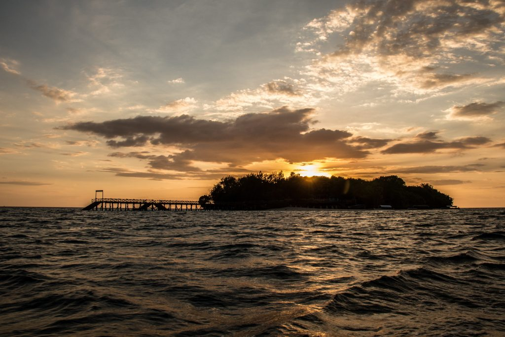 Sunset as seen when leaving Prison Island - 10 reasons to visit Zanzibar.